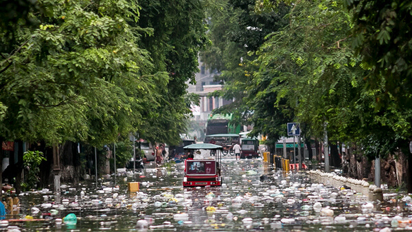 flooded garbage streets in Southeast Asia